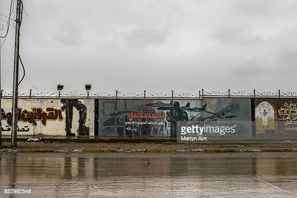 Islamic State propaganda mural painted on a wall in east Mosul Iraq on January 28 2017 The liberation of eastern Mosul was confirmed by The Iraqi...