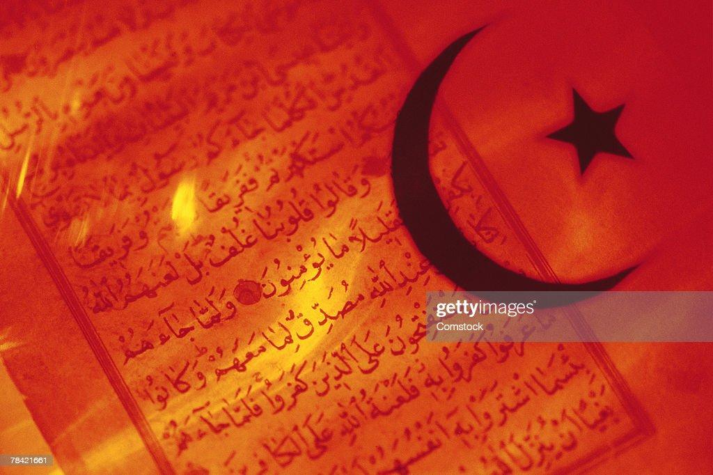 Islamic symbol over Koran : Stock Photo