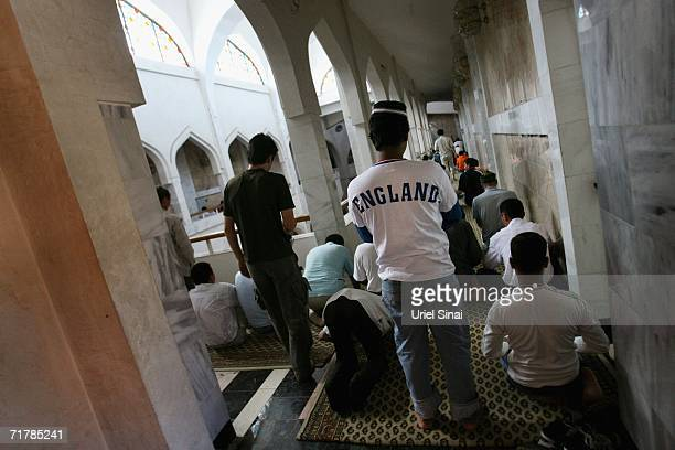 Islamic worshippers perform the rituals of their Friday Muslim prayers in the Great Mosque on August 11 2006 in Almaty in the central Asian republic...