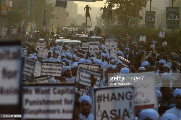 Islamist activists carry placards against Asia Bibi a Pakistani Christian woman who was recently released after spending eight years on death row for...
