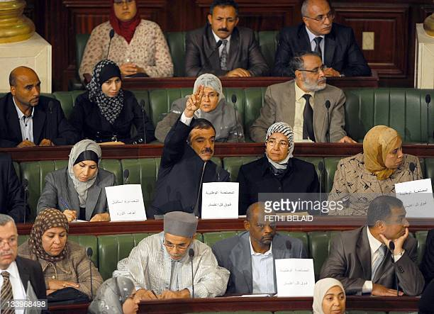 Islamist Ennahdha party deputies attend on November 23, 2011 a session of the democratically elected constituent assembly in Tunis, 10 months after a...