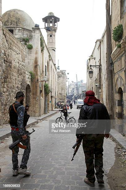 Islamist fighters in the extremist Jabhat alNusra faction head for the front line in the old city of Aleppo an ancient city divided by civil war