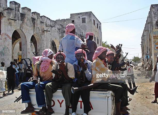 Islamist militants loyal to newly-elected President Sheikh Sharif Sheikh Ahmed patrol in Mogadishu, on February 19, 2009. Fighters took control of...