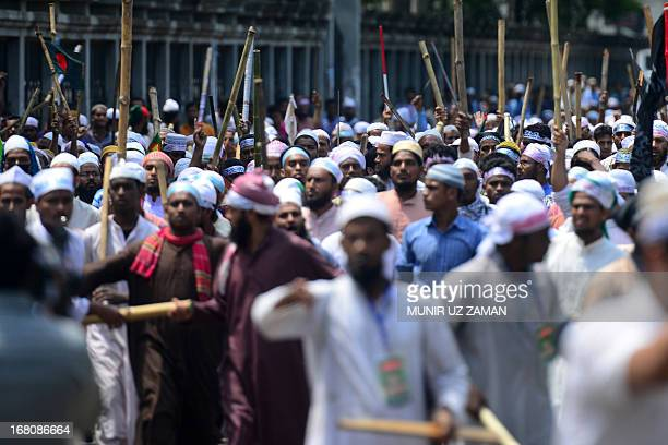 Islamists march in the street in Dhaka during a protest in Dhaka on May 5 2013 At least one person was shot dead and 35 people were injured police...
