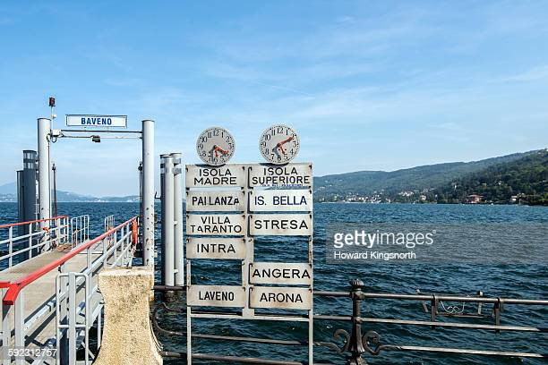 island ferry timetable clocks. lake maggiore - stresa stock pictures, royalty-free photos & images