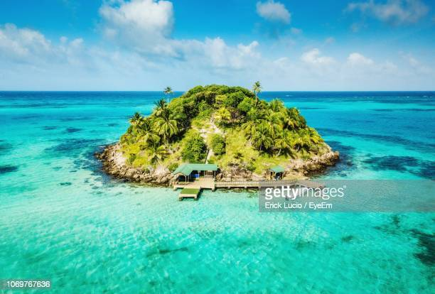 island in sea against sky - colombia stock pictures, royalty-free photos & images