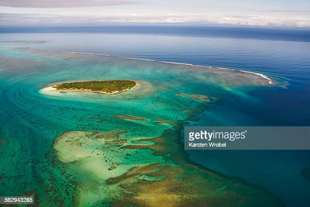 island in the coral reef of grande terre, new caledonia - new caledonia stock photos and pictures