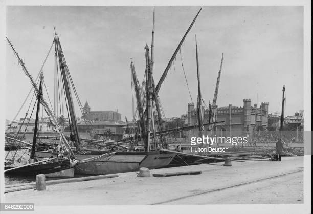 Island of Mallorca Fishing boats in the harbour of Palma In the background the old exchange built in the first half of the 15th century The old...