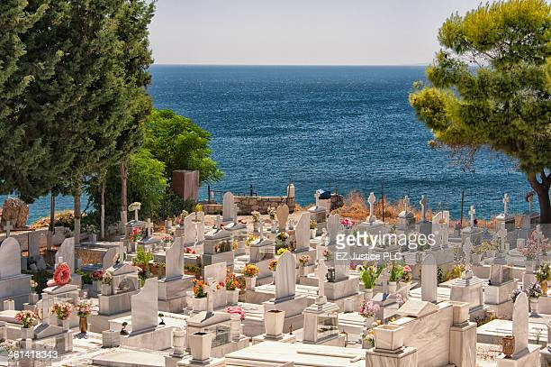 CONTENT] Island of Samos graveyard next to a church overlooking the Aegean Sea The graveyard is quite full and overflowing with tokens of remembrance