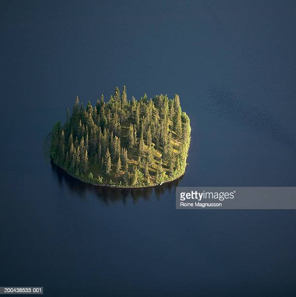 island on dark lake, aerial view - insel stock-fotos und bilder