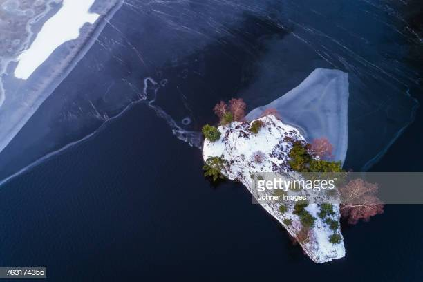 Island on frozen lake