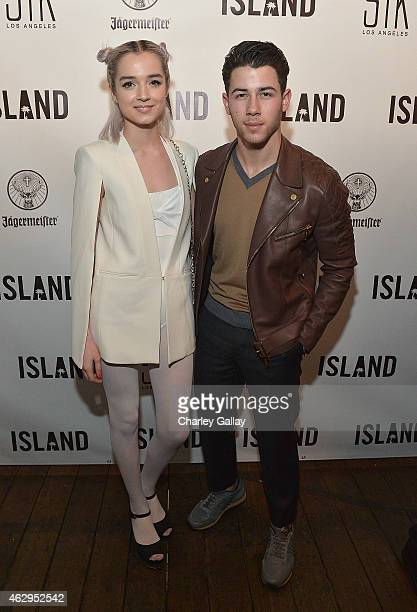 Island recording artists Poppy Nick Jonas attend Island Records PreGrammy Party Hosted By President David Massey Presented By Jagermeister at STK on...