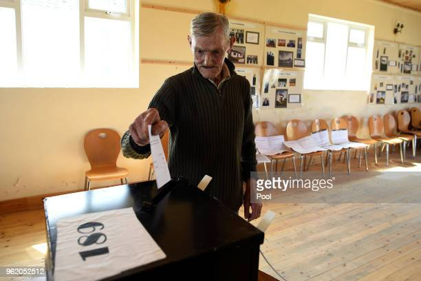 Island resident John McGinley casts his vote for the referendum on liberalising abortion law a day early for the few people that live off the coast...