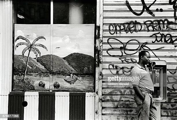 Island Scene and Graffiti on Store in Harlem