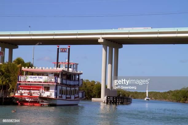 Island Time paddlewheel dinner boat going under a bridge at Jewfish Creek
