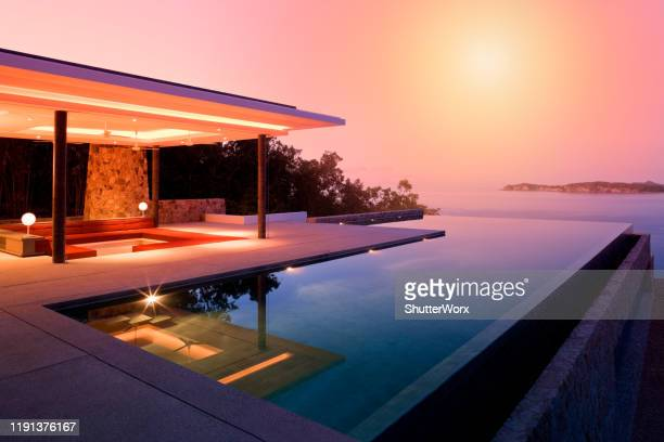 island villa - luxury stock pictures, royalty-free photos & images