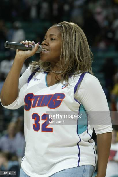 Island/Def Soul recording artist Kelly Price performs the National Anthem and a few of her hit songs in a post game concert while wearing a Andrea...