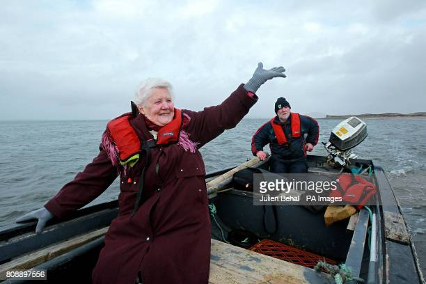 Islander Bridgie O'Malley waves goodbye to her friends on Inishbiggle as she returns home to Achill with her son Joe O'Malley on the small boat after...