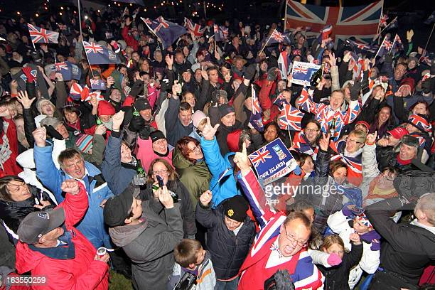 Islanders celebrate after the annouce of the referendum's result in Port Stanley Falkland Islands on March 11 2013 Falkland Islanders were to vote on...