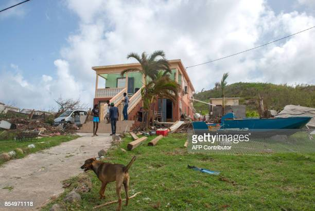 Islanders check their home after the roof was blown off in Quartier d'Orleans, on the French Caribbean island of Saint-Martin, three weeks after the...