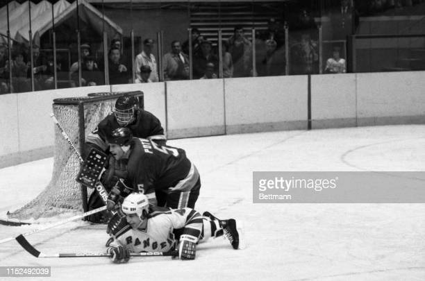 Islanders' Denis Potvin assists goalie Roland Melanson in save against Rangers' Mark Pavelich during 1st period action of NY Rangers v NY Islanders...