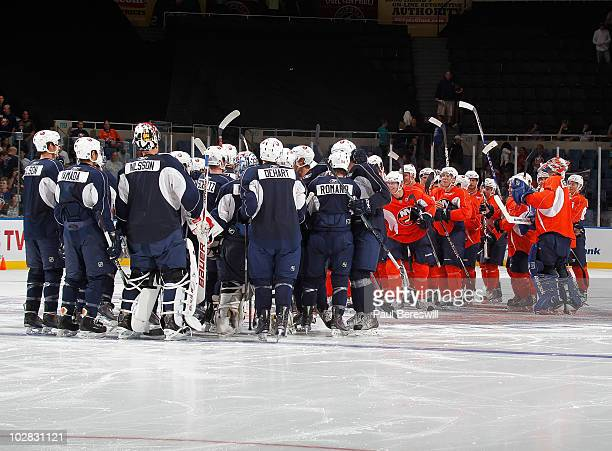 Islanders Orange team and Blue team line up to shake hands after a scrimmage during the New York Islanders Rookie camp at Nassau Veterans Memorial...