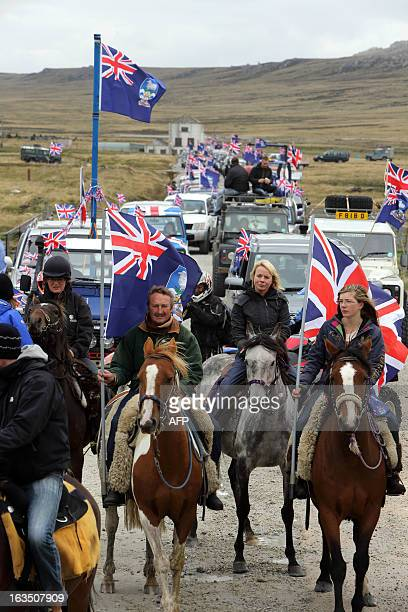 Islanders take part in the Proud to be British parade along Ross Road in Port Stanley Falkland Islands on March 10 2013 Falkland Islanders were to...