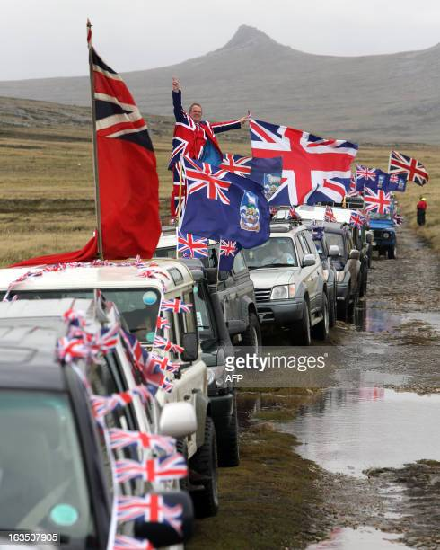 Islanders taking part in the Proud to be British parade along Ross Road in Port Stanley Falkland Islands on March 10 2013 Falkland Islanders were to...