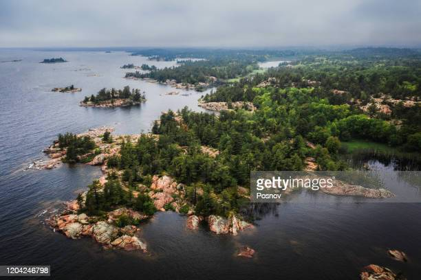 islands of georgian bay of lake huron at killarney provincial park - great lakes stock pictures, royalty-free photos & images