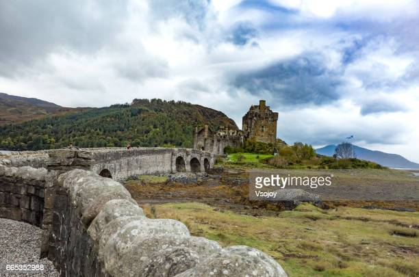 isle of skye, scotland - oct 2014, footbridge to the eilean donan castle - vsojoy stock pictures, royalty-free photos & images