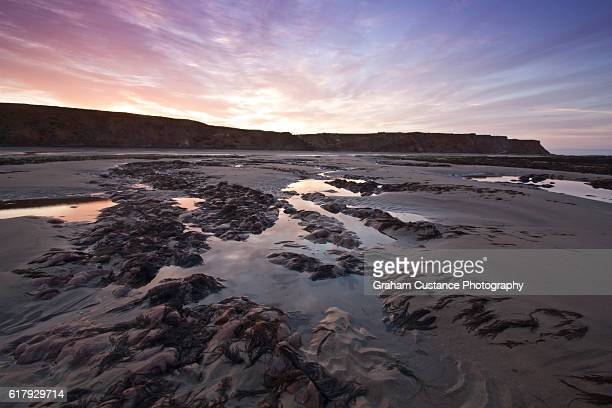 isle of wight sunrise - compton bay isle of wight stock pictures, royalty-free photos & images