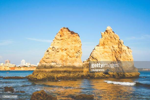 islets on the algarve coast - trapezoid stock pictures, royalty-free photos & images