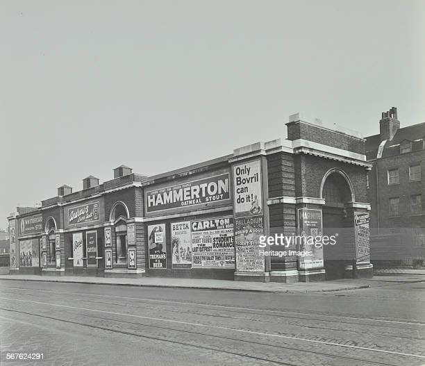 Islington Tramways SubStation and advertisements London 1936 Electricity substation with advertisements for Bovril and beer