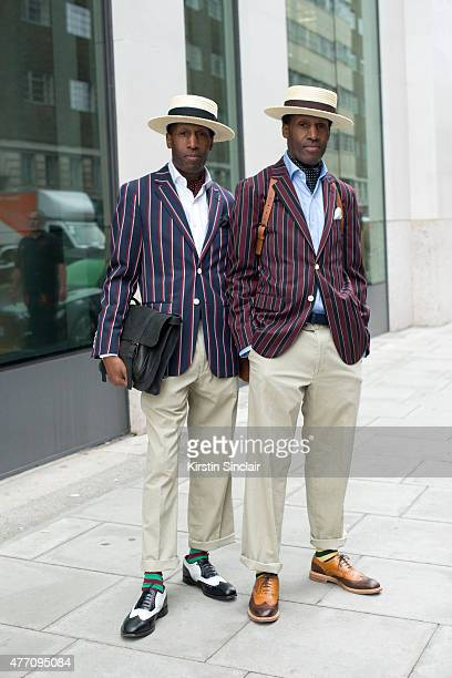 Islington Twins Chuka and Dubem Okonkwo wear all Thomas Farthing on day 2 of London Collections Men on June 13 2015 in London England