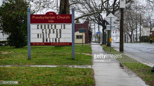 A sign at a Presbyterian church on Main Street in Islip New York reads church is closed visit us online as Long Islanders shelter in place for during...