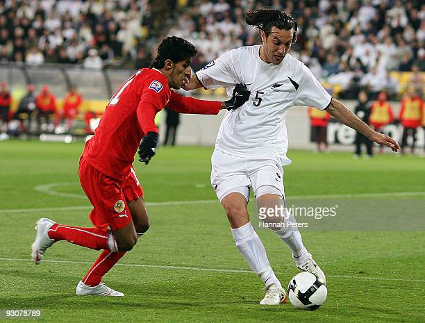 Ismaeel Abdullatif Ismaeel of Bahrain competes with Ivan Vicelich of the All Whites during the FIFA World Cup Asian Qualifying match between New...