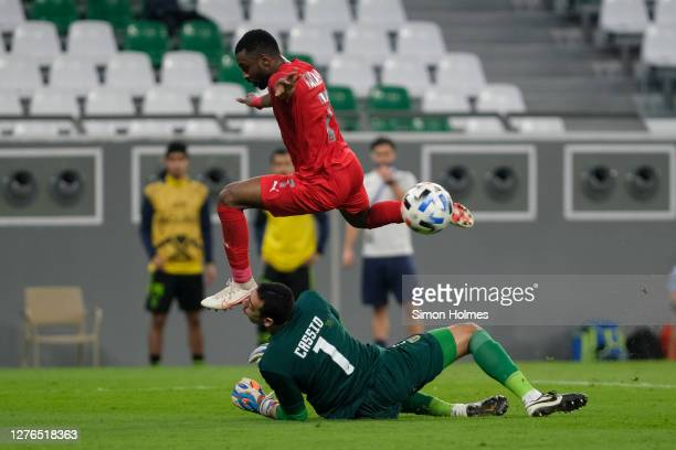 Ismaeel Mohammad of Al Duhail has a goal attempt cleared off the line after beating Al Taawoun goalkeeper Cassio during the AFC Champions League...