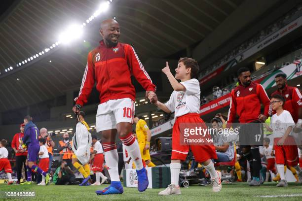 Ismaeil Matar Aljneibi of United Arab Emirates walks out with a mascot ahead of the AFC Asian Cup quarter final match between United Arab Emirates...