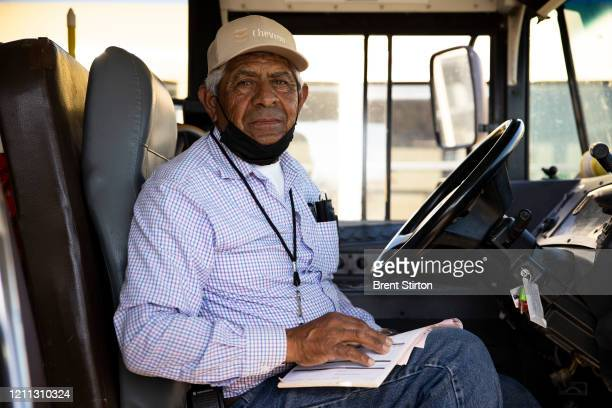 Ismael a Fresh Harvest driver sits on a bus on April 28 2020 in Greenfield California He has been driving farm laborers since he was 18 Fresh Harvest...