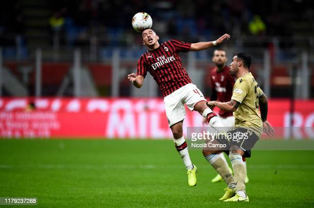 Ismael Bennacer of AC Milan competes for a header with Andrea Petagna of SPAL during the Serie A football match between AC Milan and SPAL AC Milan...