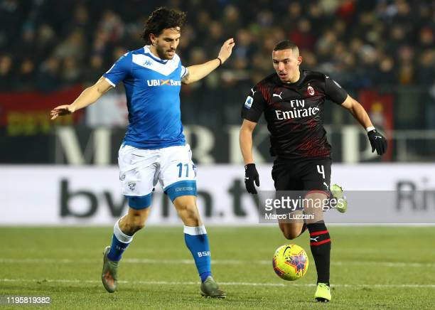 Ismael Bennacer of AC Milan competes for the ball with Ernesto Torregrossa of Brescia Calcio during the Serie A match between Brescia Calcio and AC...