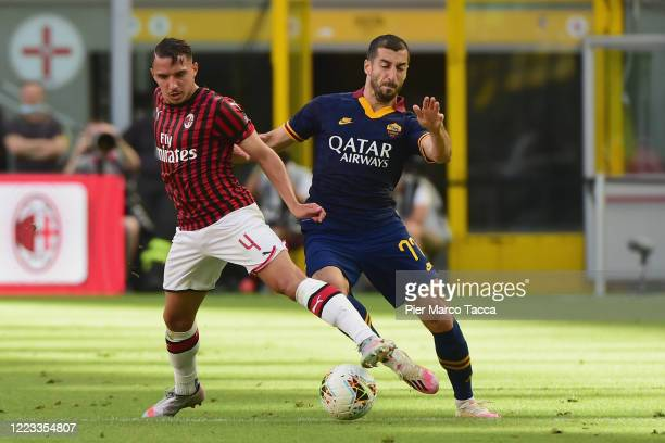 Ismael Bennacer of AC Milan competes for the ball with Henrix Hamleti Mkhitaryan of AS Roma during the Serie A match between AC Milan and AS Roma at...