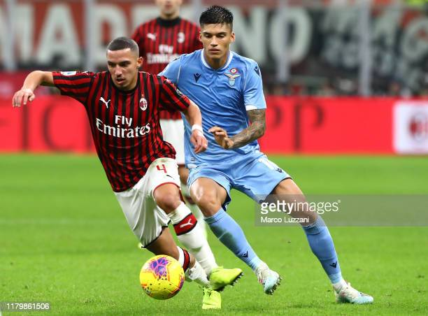 Ismael Bennacer of AC Milan competes for the ball with Joaquin Correa of SS Lazio during the Serie A match between AC Milan and SS Lazio at Stadio...