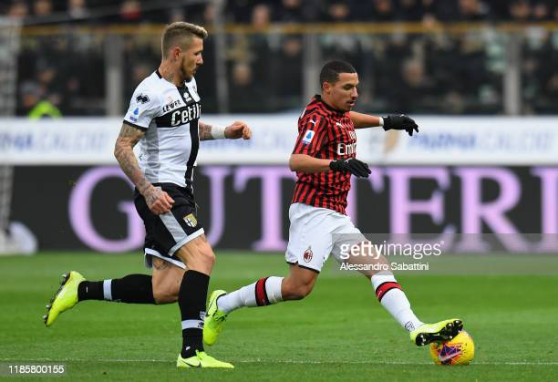 Ismael Bennacer of AC Milan competes for the ball with Juraj Kucka of Parma Calcio during the Serie A match between Parma Calcio and AC Milan at...