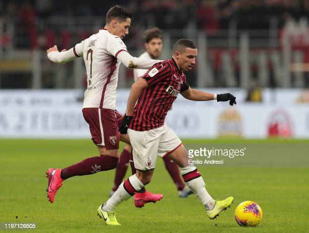 Ismael Bennacer of AC Milan is challenged by Sasa Lukic of Torino FC during the Coppa Italia Quarter Final match between AC Milan and Torino at San...