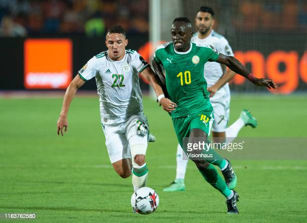 Ismael Bennacer of Algeria and Sadio Mane of Senegal during the 2019 Africa Cup of Nations Final between Senegal and Algeria at at the Cairo...