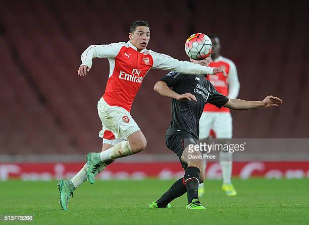 Ismael Bennacer of Arsenal is challenged by Adam Phillips of Liverpool during the match between Arsenal U18 and Liverpool U18 in the FA Youth Cup 6th...