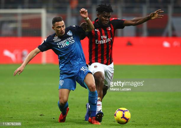 Ismael Bennacer of Empoli competes for the ball with Franck Kessie of AC Milan during the Serie A match between AC Milan and Empoli at Stadio...