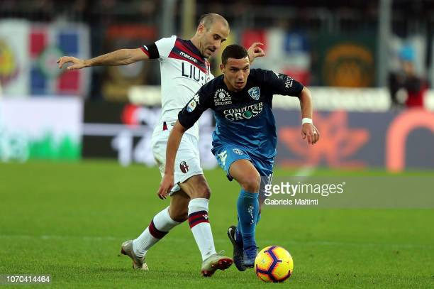 Ismael Bennacer of Empoli FC battles for the ball with Rodrigo Palacio of Bologna FC during the Serie A match between Empoli and Bologna FC at Stadio...