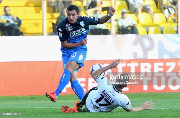 Ismael Bennacer of Empoli Fc competes for the ball with Antonino Barilla of Parma Calcio during the Serie A match between Parma Calcio and Empoli at...